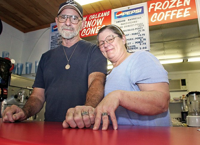 For their 44th wedding anniversary, Gabriel and Joy Daigle, owners of Mom & Pops Sandwiches, bought matching wedding rings expressing their strong Christian faith.