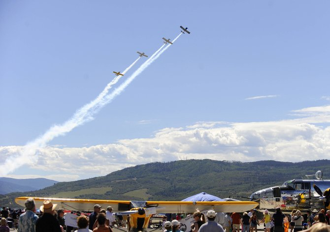 Four Victor Flight planes fly over the Wild West Air Fest at the Steamboat Springs Airport.