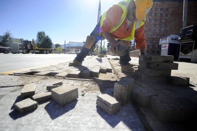 Ricardo Jimenez, with Vogelman West Associates, replaces brick Friday along U.S. Highway 40 in downtown Steamboat Springs. Major road construction will resume this week on the south side of Lincoln from Ninth Street to just east of Third Street.