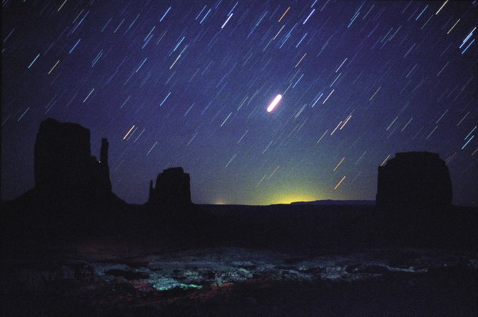 The bright object you see rising in the east after darkness falls this month is the planet Jupiter. In this time exposure taken Aug. 13 from Monument Valley, Ariz., the stars appear as short streaks because of the Earth's rotation. Jupiter made the brightest streak near the image's center. The much fainter and more distant planet Uranus made the second streak to Jupiter's upper right. Both planets reach their closest point to Earth on Sept. 21.