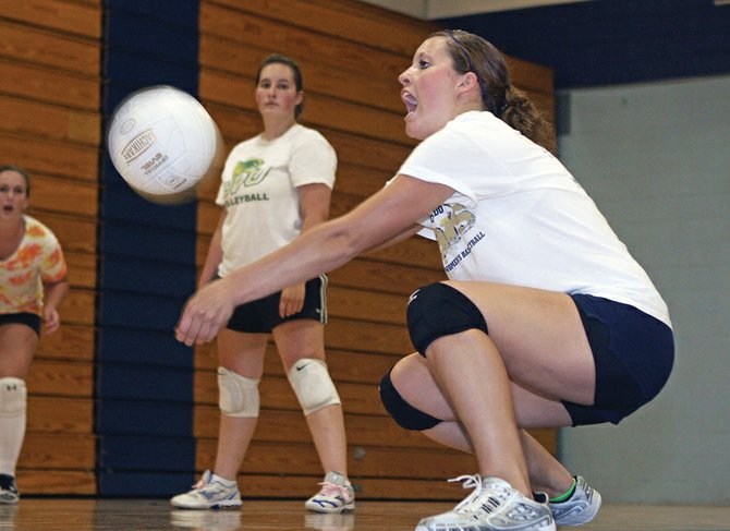 Junior Adrie Camp digs a ball during a Moffat County High School volleyball practice last month. The MCHS varsity volleyball team finished 2-2 during the Regis Jesuit tournament Friday and Saturday in Aurora.