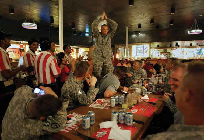 Steamboat Springs' Sgt. Charles Reed, of the 715 Military Intelligence Unit, center, celebrates his 34th birthday with his colleagues and the staff at T.G.I. Fridays restaurant on the boardwalk at Kandahar Air Force Base, Afghanistan, on Monday.