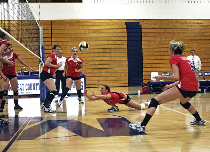 Alexana Rotunda, center, dives for a ball during Tuesday's Colorado Northwestern Community College volleyball game at Moffat County High School. The Spartans lost, 3-0, to Western Wyoming Community College in its only game in Craig this season.