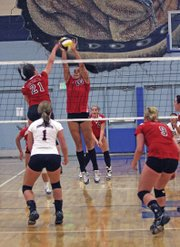 Michelle Einzinger, of CNCC, blocks a spike against Western Wyoming Community College.