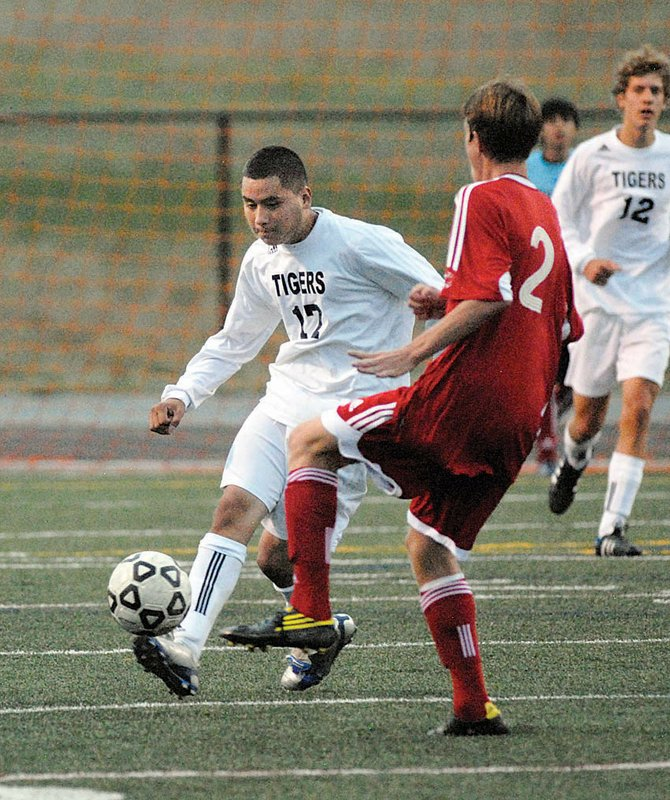 Summit High's Cesar Serrano controls the ball against a Steamboat Springs defender Tuesday evening.