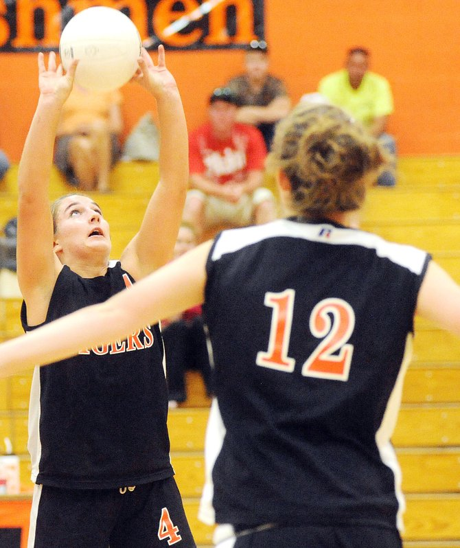 Hayden's Delanie VeDepo sets the ball for Aubree Haskins on Thursday night as the Tigers volleyball team opened its home schedule with a three-set loss to Little Snake River, from Baggs, Wyo.