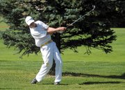 Battle Mountains Michael Wilhelm takes a swing on the 10th hole Thursday at Yampa Valley Golf Course. Wilhelm, a sophomore, hit a hole-in-one on the seventh hole during the Moffat County High School boys varsity golf teams home tournament.