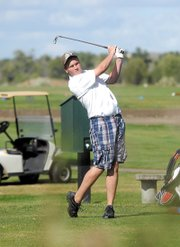 MCHS junior Trey Jourgensen tees off on the seventh hole Thursday at Yampa Valley Golf Course. Jourgensen finished with a 104. He said strong winds impacted his score.