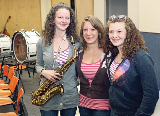 Katy Radcliffe, 15, left, Shayna Grammer, 17, middle, and Larissa Grammer, 15, stand together Wednesday in the band room at Moffat County High School. Radcliffe, an Isle of Man native, stayed with the two sisters from Aug. 22 until Friday. She met the Grammers two years ago when Katy and Larissa were in Washington, D.C. for an event.