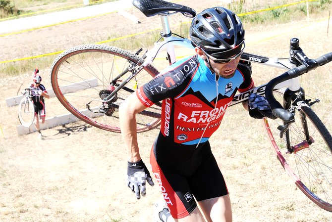 Andrew Wagner charges up a hill during Saturday's cyclocross race in Steamboat Springs.