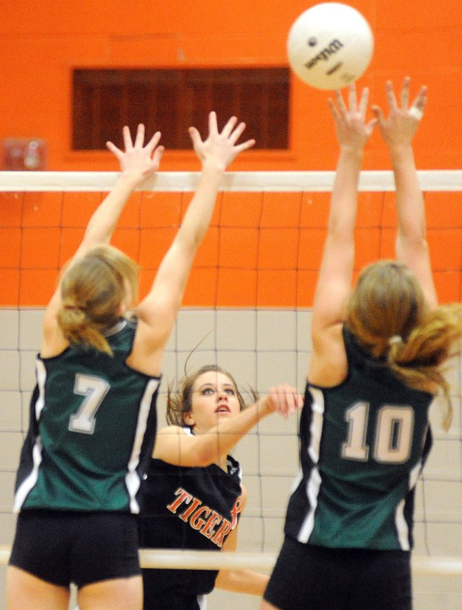 Hayden senior Morgan Bell knocks the ball clear of Plateau Valley's block Saturday as the Tigers improved to 2-1 on the season with a three-game sweep.