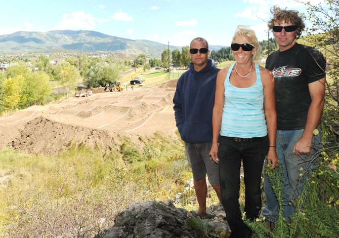 Track designer Eric Bress, track president Gina Grether and track director Brian Deem stand in front of Steamboat's newest cycling venue, the Steamboat Springs BMX track at the base of Howelsen Hill.