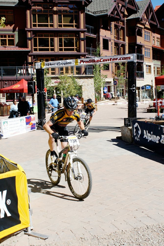 Nate Bird waits on Scott McCalmon during Saturday's 12 Hours of Snowmass. The men's duo team won the event.