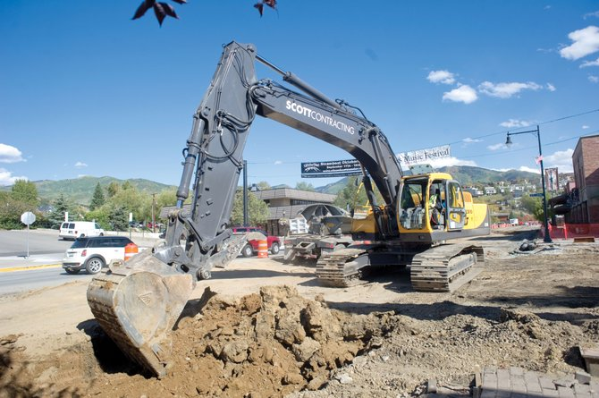 An excavator removes the old roadway along Lincoln Avenue on Monday afternoon as the downtown repaving project continues. The Colorado Department of Transportation spokeswoman Nancy Shanks said the project is a week ahead of the department's own schedule.