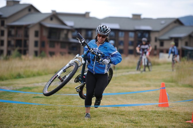 Riley Polumbus participates in a biking clinic Sept. 8.