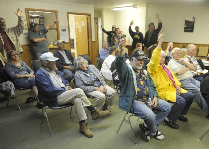 Yampa residents raise their hands in support of medical marijuana dispensaries in the town during a public meeting Wednesday night.