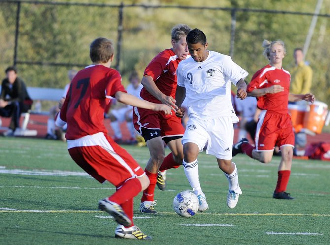 Steamboat Springs High School junior Enrique Lopez weaves through a pack of Glenwood Springs players during a Sept. 9 match. Steamboat plays at 6 p.m. today against Moffat County at Steamboat Springs High School.
