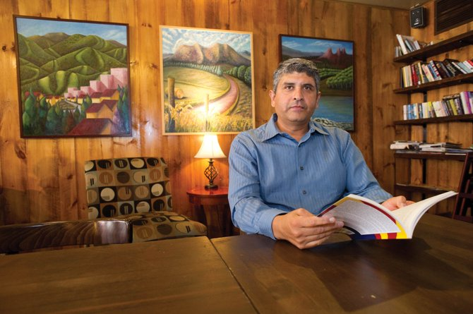 "Local author Jorge Gonzalez Avila holds a copy of his newly published book, ""La Marcha de los Rosados."" Avila will be at Steaming Bean Coffee Shop at Seventh Street and Lincoln Avenue at 11 a.m. Saturday to sign copies. The book, which is in Spanish, presents a picture of challenges, discrimination and prejudice in Maricopa County, Ariz., for Latinos."
