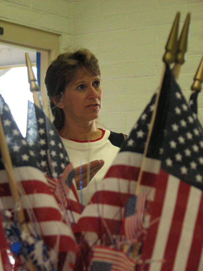 Jeanie Durham, a member of the Moffat County Tea Party, decorates American Legion Post 62 for a Constitution Day celebration Friday. The Constitution was signed 223 years ago, on Sept. 17, 1787.