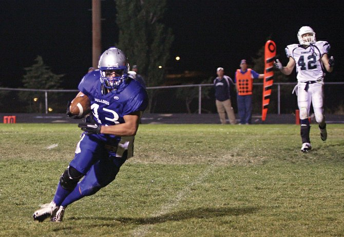 Senior tight end Brady Conner crosses the goal line after a ten-yard pass completion from sophomore quarterback Bubba Ivers to win the game against John F. Kennedy High School in the final minute Friday at the Bulldog Proving Grounds. The Bulldogs came from behind with 1:33 left on the clock to win, 27-20.