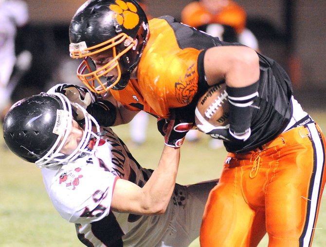 Hayden's Treyben Letlow tries to plow through a Grand Valley defender in the fourth quarter of Friday night's game. That late offensive spurt wasn't enough for the Tigers, who couldn't turn five Cardinal fumbles into a victory. Hayden lost, 17-12.