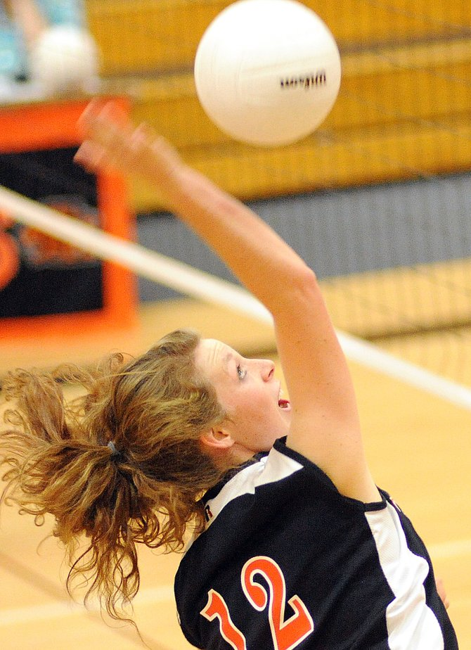 Hayden junior Aubree Haskins swings for the ball Friday as the Tigers beat North Park, 25-13, 25-16, 20-25 and 25-14.