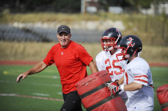 Tim Krumrie, who spent 27 years in the NFL in varied capacities, runs drills during practice Wednesday. Krumrie has joined the Steamboat Springs High School football coaching staff.