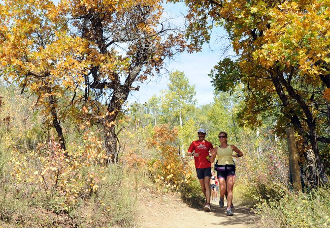 Geoff Roes and Cara Marrs run Friday during a 5-mile trail run on Spring Creek. Roes is a well-known ultramarathon runner who was in Steamboat Springs for Saturday's Run, Rabbit Run 50-mile race.