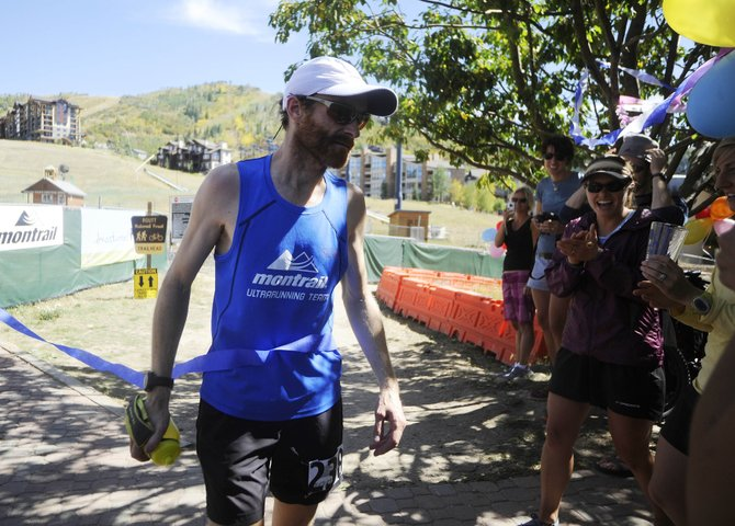 Geoff Roes crosses the finish line of Saturday's Run, Rabbit Run 50-mile trail ultramarathon. Roes broke the course record with a time of 7 hours, 11 minutes and 36 seconds.