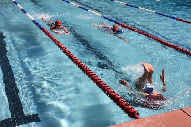 Participants swim in the Old Town Hot Springs pool Sunday during the Laps for Lindsay fundraiser. Twenty-six people swam 1,200 laps during the event, which was put on to benefit Lindsay Labaree Bathke, a 1998 Steamboat Springs High School graduate recovering from a swollen blood vessel in her brain.