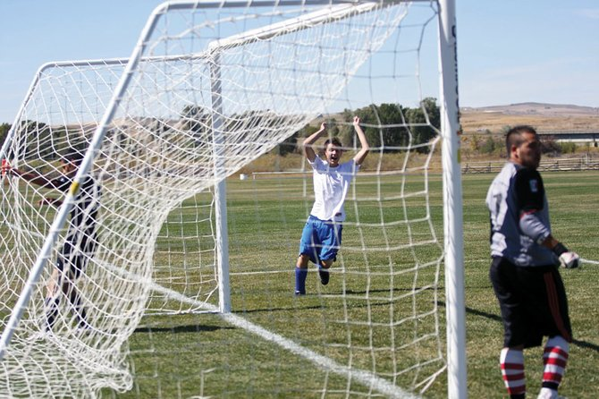 Moffat County High School junior Cody Fallon celebrates after scoring his first goal of the season during a 12-4 pummeling of Eagle Valley High School on Saturday at Loudy-Simpson Park.