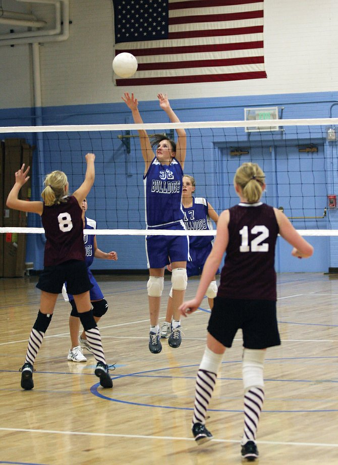 Taylor Hayger goes up for a block during the Craig Middle School eighth-grade volleyball match against Soroco Middle School on Wednesday at CMS. Soroco won the match in two sets, 25-18 and 25-15. The eighth-grade team's record is now 2-4.