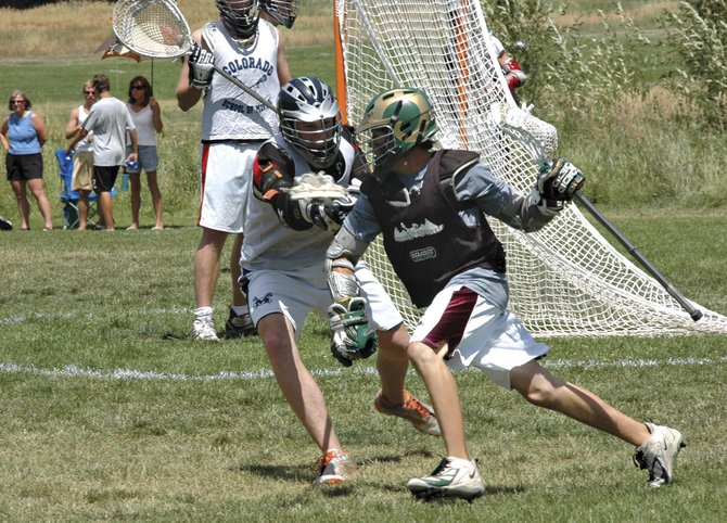 Steamboat's Jake Flax, right, works for a shot at the 2007 Steamboat Lacrosse Tournament. Flax was named a captain of Colorado State University's lacrosse team.