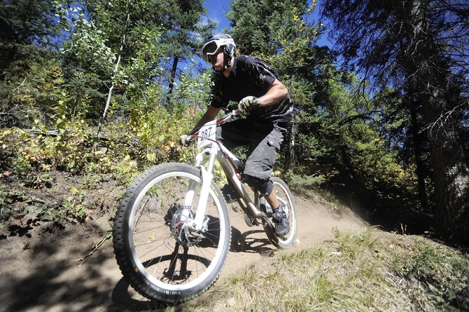 Greg Jansen rides down Creekside Trail during the Sept. 18 downhill race.