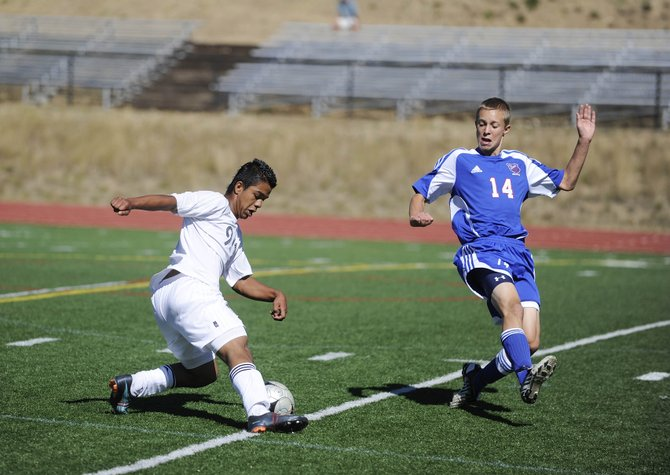 Steamboat Springs High School's Enrique Lopez tries to control the ball during Saturday's game against Centaurus High School in Steamboat.