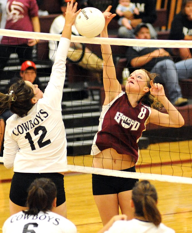 Soroco senior Corey Snyder wins a battle at the net Saturday as her Rams beat Meeker in four games.