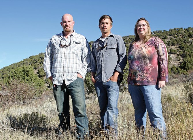 Luke Schafer, left, and Sasha Nelson, right, employees of the Colorado Environmental Coalition, stand with Soren Jespersen, of The Wilderness Society, at the base of Cedar Mountain. The three local environmental reps have come to rely on each other when addressing local issues, and developed a friendship in the process.