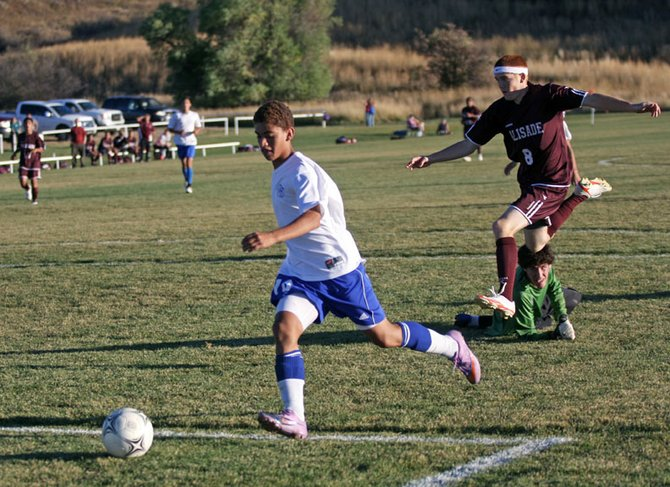 Sophomore Alan Flores beats the Palisade goalkeeper and defenders for a goal Friday at Loudy-Simpson Park. Moffat County High School beat Palisade High School, 8-2. Flores scored two goals during the game, both unassisted.