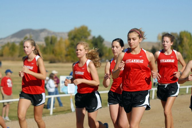 The Steamboat Springs High School girls cross-country team warms up Saturday during the Moffat County Invitational. Steamboat placed third out of four teams in the event