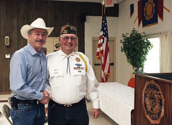 U.S. Rep. John Salazar, D-Colo., left, shakes hands with Larry Neu, a member of Veterans of Foreign Wars Post 4265, on Saturday at the American Legion. During Salazar's visit, he announced he has introduced a federal resolution to rename the Craig VA Telehealth Outreach Clinic after Major William E. Adams, a Medal of Honor recipient and former Craig resident.