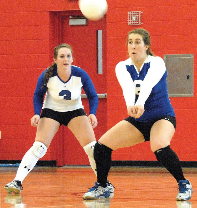 Junior Morgan Knob, right, readies herself for a bump during Moffat County High School's road game Saturday against Glenwood Springs. The Bulldogs won three of the five sets. The team's record now stands at 4-6 overall and 1-2 in the Western Slope League.