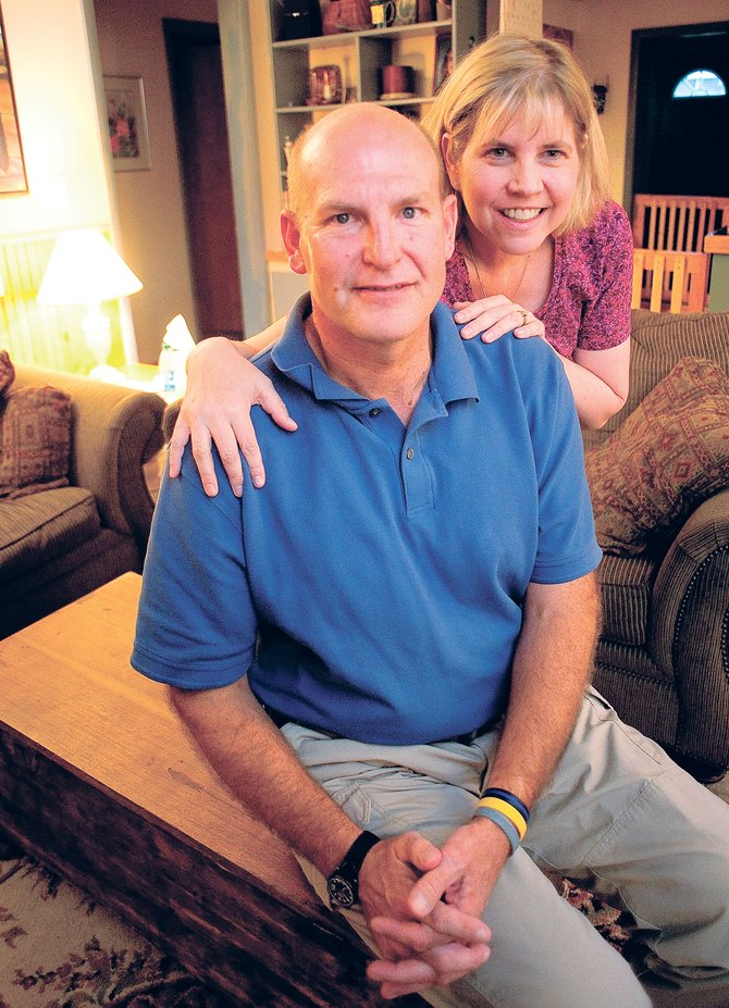 Dale Coyner, a sergeant with the Steamboat Springs Police Department, sits with his wife Judy inside the couple's home while sharing the details of Dale's battle with esophageal cancer earlier this week.