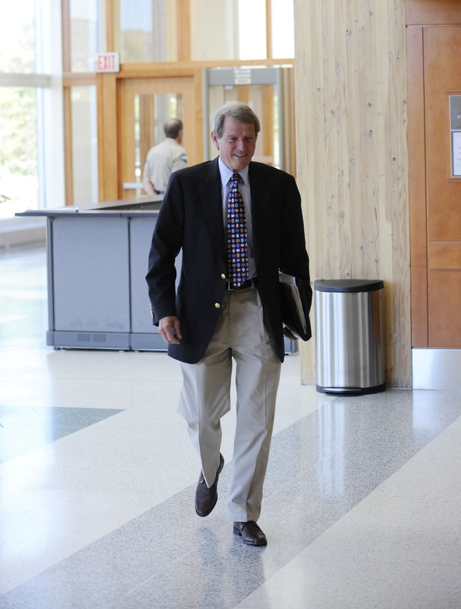 Routt County Sheriff Gary Wall enters the Routt County Justice Center on Tuesday.  Wall said law firms are unwilling to represent him because they are not sure how they would be paid, and he doesnt have the money to pay the attorneys fees himself. 