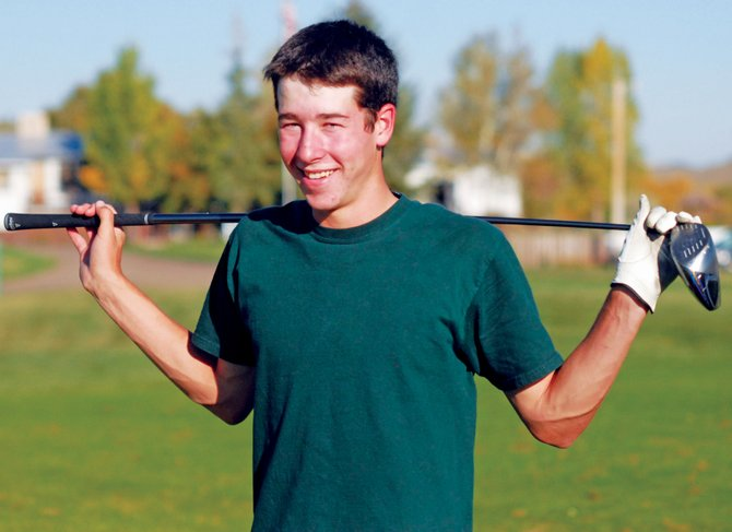 Moffat County High School golfer Parker King poses with his driver Wednesday afternoon at the Yampa Valley Golf Course. King, a junior, tees off Monday at the 4A state golf tournament as the first MCHS golfer to qualify for state since 2002.