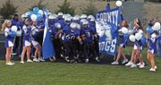 The MCHS football team makes its entrance to the field for the homecoming game Friday at the Proving Grounds. The grand stands filled to capacity with fans supporting their MCHS Bulldogs.