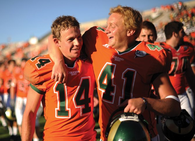 Colorado State University kicker Ben DeLine, left, and punter Pete Kontodiakos celebrate winning the game Saturday against the University of Idaho at Hughes Stadium. DeLine scored the winning field goal. CSU won, 36-34.