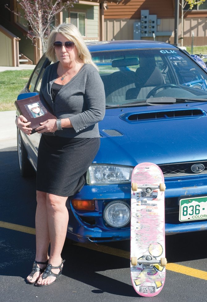 Jackie Saari, mother of Stephen Thomas, is surrounded by the reminders of her late son. His car, skateboard and a photo album hold treasured memories for Saari, who is attempting to cope with the circumstances that surround her son's death.