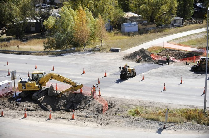 A crew works on a water line project Saturday near the intersection of U.S. Highway 40 and Indian Trails.  The city is beginning work on an estimated $70 million in water and wastewater infrastructure improvements.