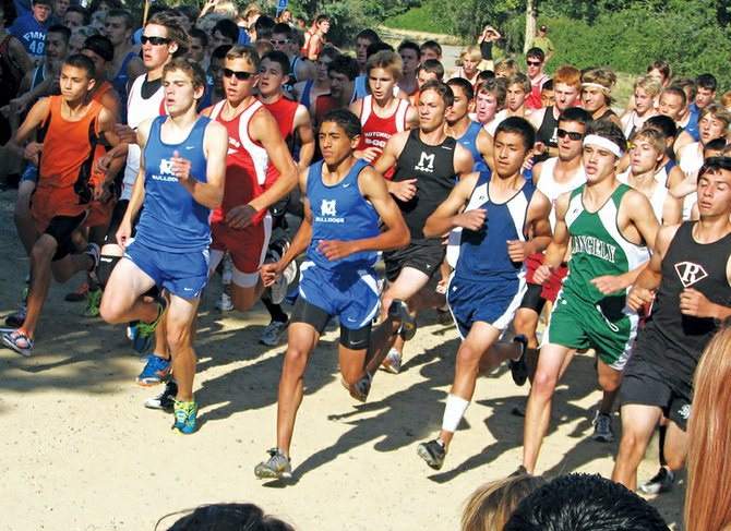 Moffat County High School runners Chris Zirkle, left, and Alfredo Lebron, center in blue, take off at the beginning of the Anna Banana Memorial Wildcat Invitational on Saturday in Grand Junction. Zirkle and Lebron placed first and second respectively in the boys race, while the boys cross-country team placed first overall. The girls team placed second overall.