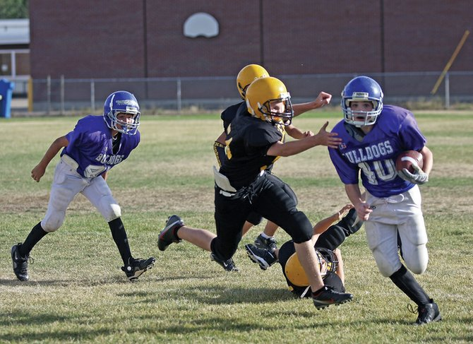 Brett Loyd tries to turn the corner during the second quarter of the seventh-grade football game against Meeker on Tuesday at Craig Middle School. The seventh-grade team won, 28-6, while the eighth-graders also took home a victory, 36-8. Both teams have 6-0 records for the season and will finish up the year against Steamboat Springs on Saturday.